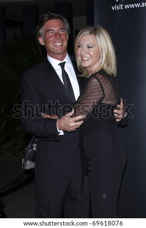 LOS ANGELES - JAN 22:  John Easterling, Olivia Newton John arrives at the 2011 G'Day USA Australia Week LA Black Tie Gala at Hollywood Palladium on January 22, 2011 in Los Angeles, CA - stock photo