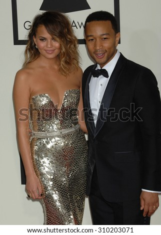 LOS ANGELES - JAN 26:  John Legend and Christine Teigen arrives at the 56th Annual Grammy Awards Arrivals  on January 26, 2014 in Los Angeles, CA                 - stock photo