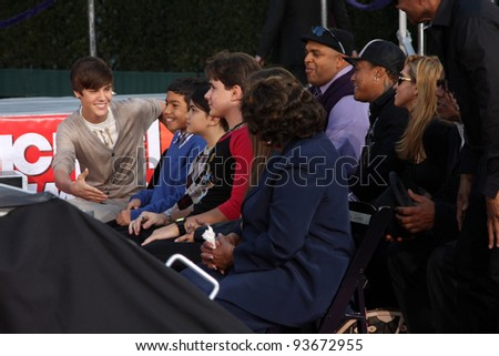 LOS ANGELES - JAN 26:  Justin Bieber meeting Jackson Family at the Michael Jackson Immortalized  Handprint and Footprint Ceremony at Graumans Chinese Theater on January 26, 2012 in Los Angeles, CA