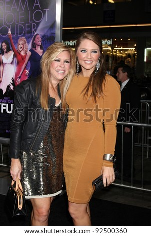 "LOS ANGELES - JAN 9:  Leigh Anne Tuohy, Collins Tuohy arrives at the""Joyful Noise"" Premiere at Graumans Chinese Theater on January 9, 2012 in Los Angeles, CA"