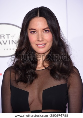 "LOS ANGELES - JAN 21:  Olivia Munn arrives to the ""Mortdecai"" Los Angeles Premiere  on January 21, 2015 in Hollywood, CA                 - stock photo"