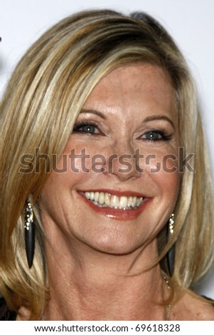 LOS ANGELES - JAN 22:  Olivia Newton-John arrives at the 2011 G'Day USA Australia Week LA Black Tie Gala at Hollywood Palladium on January 22, 2011 in Los Angeles, CA - stock photo
