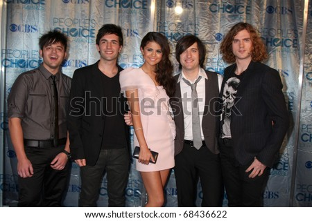 "LOS ANGELES - JAN 5:  Selena Gomez & ""The Source"" (Her band) arrives at 2011 People's Choice Awards at Nokia Theater at LA Live on January 5, 2011 in Los Angeles, CA - stock photo"