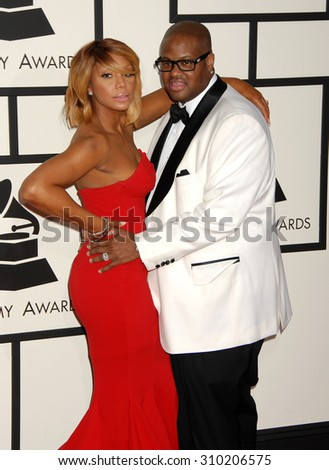 LOS ANGELES - JAN 26:  Tamara Braxton and Vincent Herbert arrives at the 56th Annual Grammy Awards Arrivals  on January 26, 2014 in Los Angeles, CA                 - stock photo
