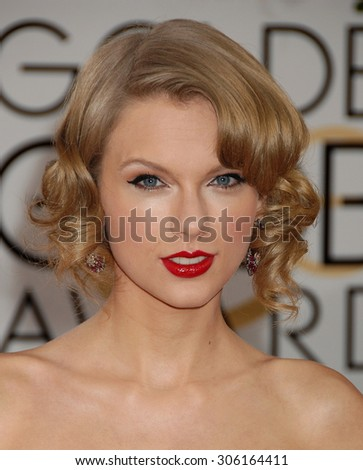 LOS ANGELES - JAN 12:  Taylor Swift arrives to the 2014 Golden Globe Awards  on January 12, 2014 in Beverly Hills, CA                 - stock photo
