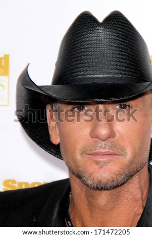 LOS ANGELES - JAN 14:  Tim McGraw at the 50th Anniversary Of Sports Illustrated Swimsuit Issue at Dolby Theater on January 14, 2014 in Los Angeles, CA - stock photo