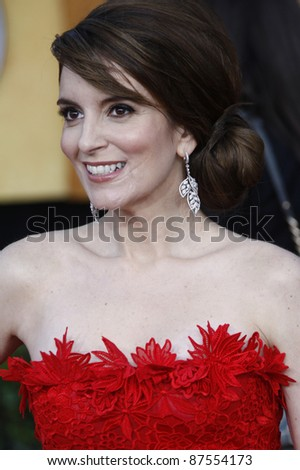 LOS ANGELES - JAN 30: Tina Fey arrives at The 17th Annual SAG Awards held at the Shrine Auditorium on January 30, 2011 in Los Angeles, California. - stock photo
