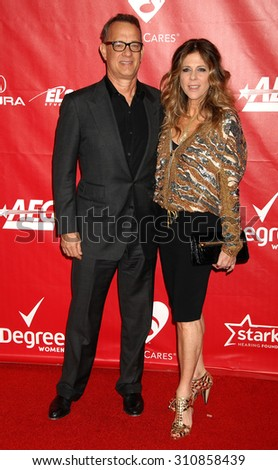 LOS ANGELES - JAN 24:  Tom Hanks and Rita Wilson arrives at the 2014 MusiCares Person Of The Year Honoring Carole King  on January 24, 2014 in Los Angeles, CA                 - stock photo