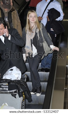 LOS ANGELES - JANUARY 25: Actress Dakota Fanning is seen all msiles as she arrives at LAX airport. January 25, 2010 in los angeles, california - stock photo