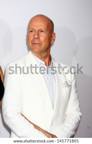 """LOS ANGELES - JUL 11:  Bruce Willis arrives at the """"Red 2"""" Premiere at the Village Theater on July 11, 2013 in Westwood, CA - stock photo"""