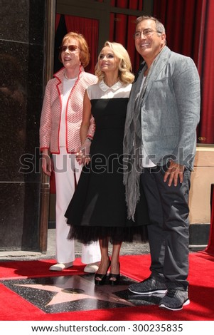 LOS ANGELES - JUL 24:  Carol Burnett, Kristin Chenoweth, Kenny Ortega at the Kristin Chenoweth Hollywood Walk of Fame Star Ceremony at the Hollywood Blvd on July 24, 2015 in Los Angeles, CA - stock photo