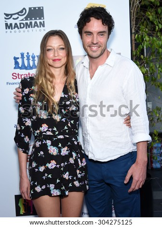"LOS ANGELES - JUL 20:  Damon Gameau & Zoe Tuckwell-Smith arrives to the ""That Sugar Film"" US Premiere  on July 20, 2015 in Hollywood, CA                 - stock photo"