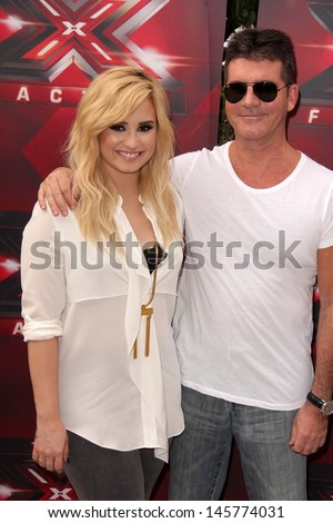 "LOS ANGELES - JUL 11:  Demi Lovato, Simon Cowell at the ""X-Factor"" Season 3 Photo Call at the Galen Center on July 11, 2013 in Los Angeles, CA - stock photo"