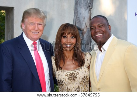 LOS ANGELES - JUL 24:  Donald Trump, Holly Peete, & Rodney Peete arrive at  the 12th Annual HollyRod Foundation  Event at  Green Acres Estate on July24, 2010 in Beverly Hills, CA - stock photo