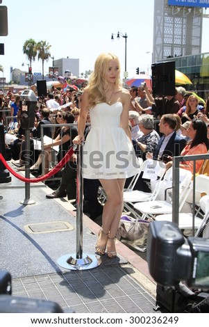 LOS ANGELES - JUL 24:  Dove Cameron at the Kristin Chenoweth Hollywood Walk of Fame Star Ceremony at the Hollywood Blvd on July 24, 2015 in Los Angeles, CA - stock photo