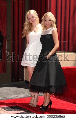 LOS ANGELES - JUL 24:  Dove Cameron, Kristin Chenoweth at the Kristin Chenoweth Hollywood Walk of Fame Star Ceremony at the Hollywood Blvd on July 24, 2015 in Los Angeles, CA - stock photo