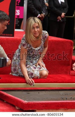 LOS ANGELES - JUL 7:  Jennifer Aniston at the Jennifer Aniston Handprint & Footprint Ceremony at Grauman's Chinese on July 7, 2011 in Los Angeles, CA