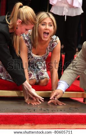 LOS ANGELES - JUL 7:  Jennifer Aniston at the Jennifer Aniston Handprint & Footprint Ceremony at Grauman's Chinese on July 7, 2011 in Los Angeles, CA - stock photo