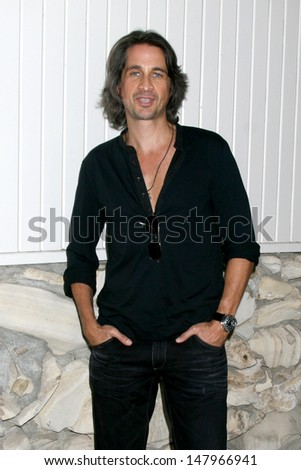 LOS ANGELES - JUL 27:  Michael Easton arrives at the 2013 General Hospital Fan Club Luncheon  at the Sportsman's Lodge on July 27, 2013 in Studio City, CA - stock photo