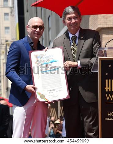 LOS ANGELES - JUL 15:  Pitbull aka Armando Christian Perez & Leron Gubler arrives to the Walk of Fame honors Pitbull on July 15, 2016 in Hollywood, CA                 - stock photo