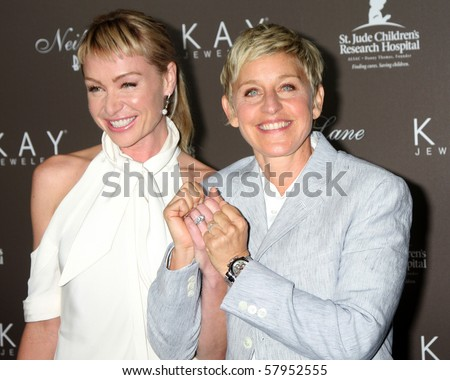 LOS ANGELES - JUL 22:  Portia DeRossi & Ellen DeGeneres arrive at the Neil Lane Bridal Collection Debut at Drai's at The W Hollywood Rooftop on July 22, 2010 in Los Angeles, CA .... - stock photo