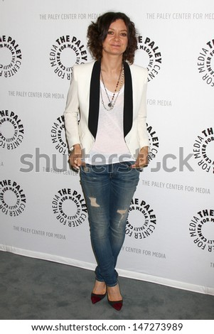 """LOS ANGELES - JUL 16:  Sara Gilbert arrives at  """"An Evening With Web Therapy: The Craze Continues..."""" at the Paley Center for Media on July 16, 2013 in Beverly Hills, CA - stock photo"""