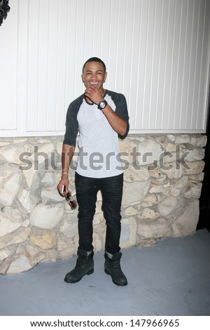 LOS ANGELES - JUL 27:  Tequan Richmond arrives at the 2013 General Hospital Fan Club Luncheon  at the Sportsman's Lodge on July 27, 2013 in Studio City, CA - stock photo