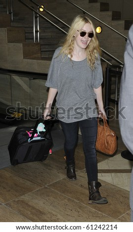 LOS ANGELES-JULY 11: Actress Dakota Fanning is seen at LAX. July 11, 2010 in Los Angeles, California - stock photo