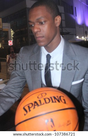 LOS ANGELES - JULY 11, 2012: Boston Celtic star Rajon Rondo signs a few autographs leaving the Espy's at L. A. Live and the Nokia Theatre July 11, 2012 downtown Los Angeles CA. - stock photo