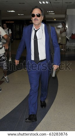 LOS ANGELES-JULY 27: Director/Producer Oliver Stone is seen at LAX . July 27th, 2010 in Los Angeles, California