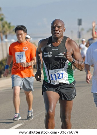 LOS ANGELES, JULY 12: Henry Kono competing in the 16th annual Keep LA Running 5KRace July 12, 2009 at Dockweiler State Beach in Playa del Rey, Los Angles, CA.