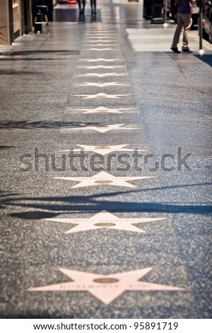LOS ANGELES - JULY 19: Hollywood Walk of Fame in Hollywood Boulevard on July 19, 2011 in Los Angeles, CA. There are more than 2,400 five-pointed stars which attract about 10 million visitors annually - stock photo