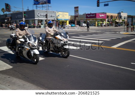 LOS ANGELES - July 23, 2014: President Barack Obama's motorcade crossing corner of 3rd Street and La Brea Avenue during presidential visit to LA. - stock photo