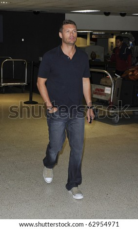 LOS ANGELES-JULY 14: Television/radio presenter Ryan Seacrest at LAX. July 14th, 2010 in Los Angeles, California