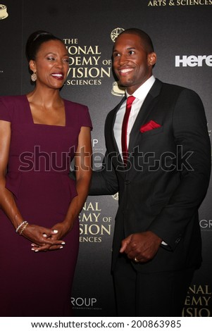 LOS ANGELES - JUN 22:  Aisha Tyler, Lawrence Saint-Victor at the 2014 Daytime Emmy Awards Arrivals at the Beverly Hilton Hotel on June 22, 2014 in Beverly Hills, CA - stock photo