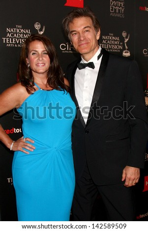 LOS ANGELES - JUN 16:  Dr. Mehmet Oz, wife arrives at the 40th Daytime Emmy Awards at the Skirball Cultural Center on June 16, 2013 in Los Angeles, CA