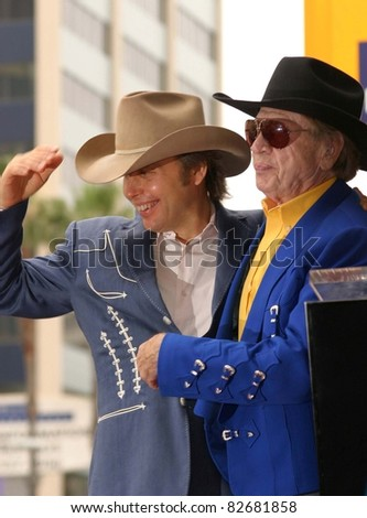 LOS ANGELES - JUN 5: Dwight Yoakam; Buck Owens at a ceremony where Dwight Yoakam receives a star in Los Angeles, California on June 5, 2003