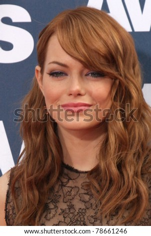 LOS ANGELES - JUN 5:  Emma Stone arriving at the the 2011 MTV Movie Awards at Gibson Ampitheatre on June 5, 2011 in Los Angeles, CA - stock photo