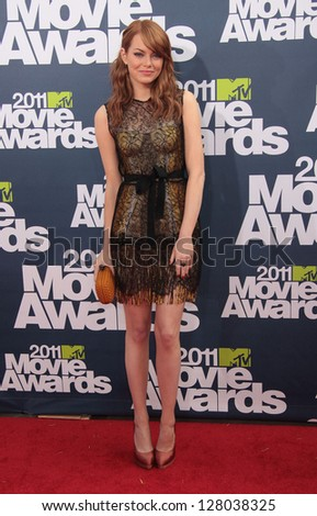 LOS ANGELES - JUN 05:  EMMA STONE arriving to MTV Movie Awards 2011  on June 05, 2011 in Hollywood, CA - stock photo