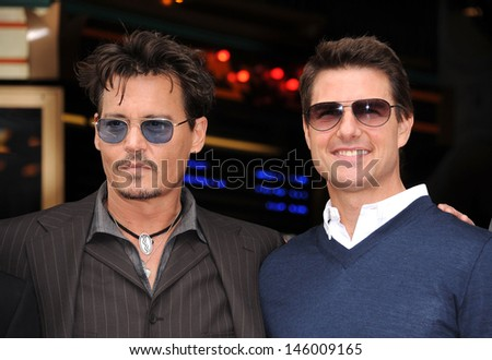 LOS ANGELES - JUN 23:  Johnny Depp &Tom Cruise arrives to the Walk of Fame Honors Jerry Bruckheimer  on June 23, 2013 in Hollywood, CA                 - stock photo