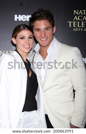 LOS ANGELES - JUN 22:  Kate Mansi, Casey Moss at the 2014 Daytime Emmy Awards Arrivals at the Beverly Hilton Hotel on June 22, 2014 in Beverly Hills, CA - stock photo