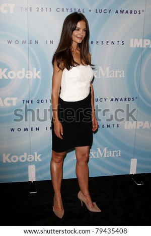LOS ANGELES - JUN 16:  Katie Holmes arrives at the 2011 Women In Film Crystal + Lucy Awards  at Beverly Hilton Hotel  on June 16, 2011 in Beverly Hills, CA - stock photo