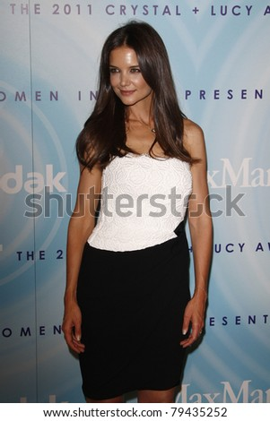 LOS ANGELES - JUN 16:  Katie Holmes arriving at the 2011 Women In Film Crystal + Lucy Awards  at Beverly Hilton Hotel  on June 16, 2011 in Beverly Hills, CA - stock photo