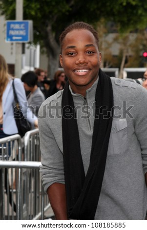 """LOS ANGELES - JUN 8:  Leon Thomas III arriving at the """"Super 8"""" Premiere at Village Theater on June 8, 2011 in Westwood, CA - stock photo"""
