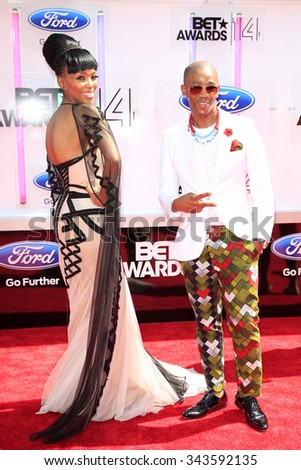 LOS ANGELES - JUN 29:  Nhlanhla Nciza, Theo Kgosinkwe at the 2014 BET Awards - Arrivals at the Nokia Theater at LA Live on June 29, 2014 in Los Angeles, CA - stock photo