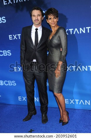 LOS ANGELES - JUN 06:  Olivier Martinez & Halle Berry arrives to the 'Extant' Premiere Party  on June 06, 2014 in Los Angeles, CA                 - stock photo