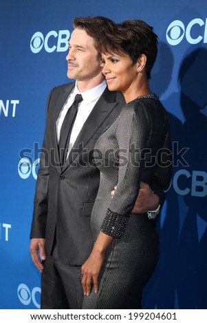 "LOS ANGELES - JUN 16:  Olivier Martinez, Halle Berry at the ""Extant"" Premiere Screening at the California Science Center on June 16, 2014 in Los Angeles, CA - stock photo"