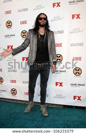 LOS ANGELES - JUN 26:  Russell Brand arrives at the FX Summer Comedies Party at Lure on June 26, 2012 in Los Angeles, CA - stock photo