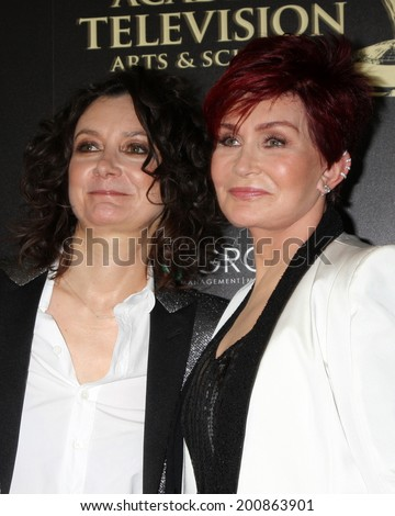 LOS ANGELES - JUN 22:  Sara Gilbert, Sharon Osbourne at the 2014 Daytime Emmy Awards Arrivals at the Beverly Hilton Hotel on June 22, 2014 in Beverly Hills, CA - stock photo