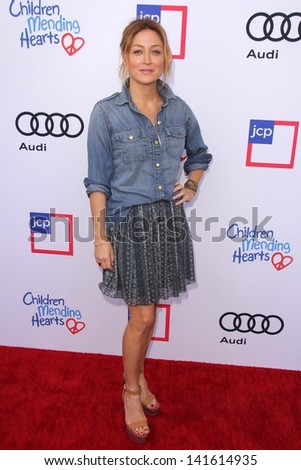 LOS ANGELES - JUN 8:  Sasha Alexander arrives at the 1st Annual Children Mending Hearts Style Sunday at the Private Residence on June 8, 2013 in Beverly Hills, CA - stock photo